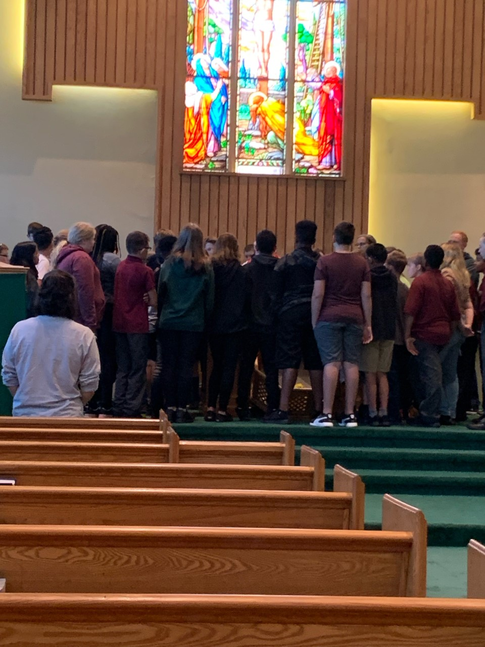 Students standing in a church