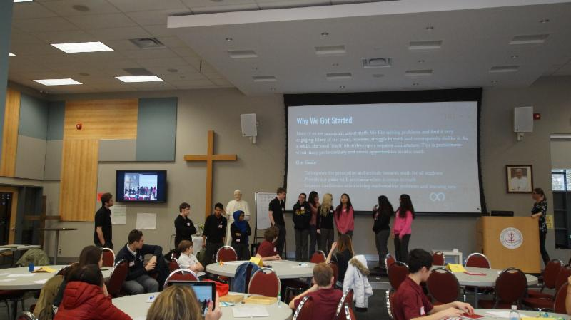 Students from Father Leo J. Austin Catholic Secondary School share ideas from their Math Council