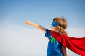 child wearing a super hero cape and eye mask