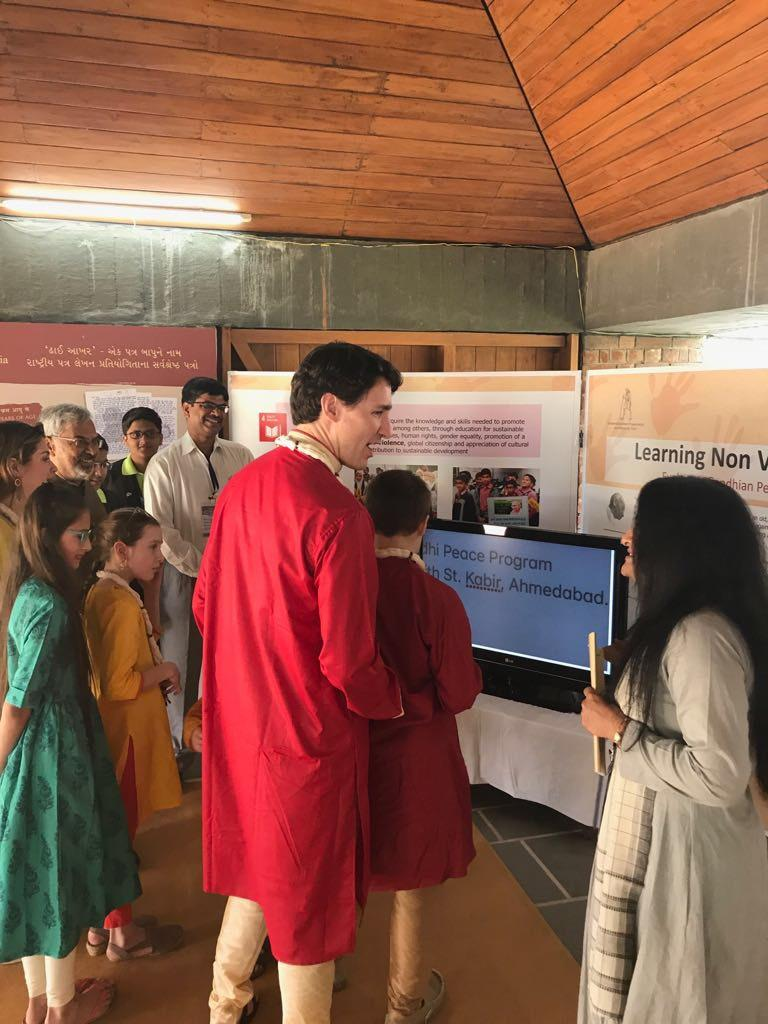 Prime Minister talking to adult woman at a school in India