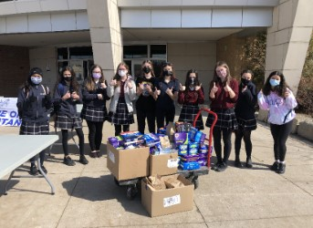 The Riveters with products from the menstrual product drive