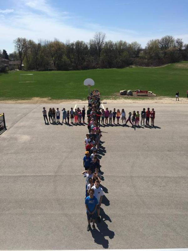 Students form a cross outside