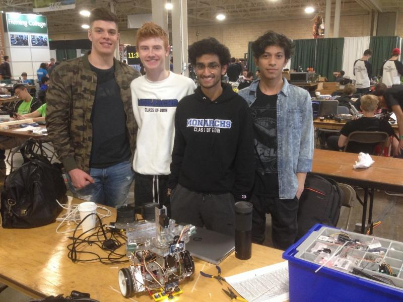 Four male students and their robot
