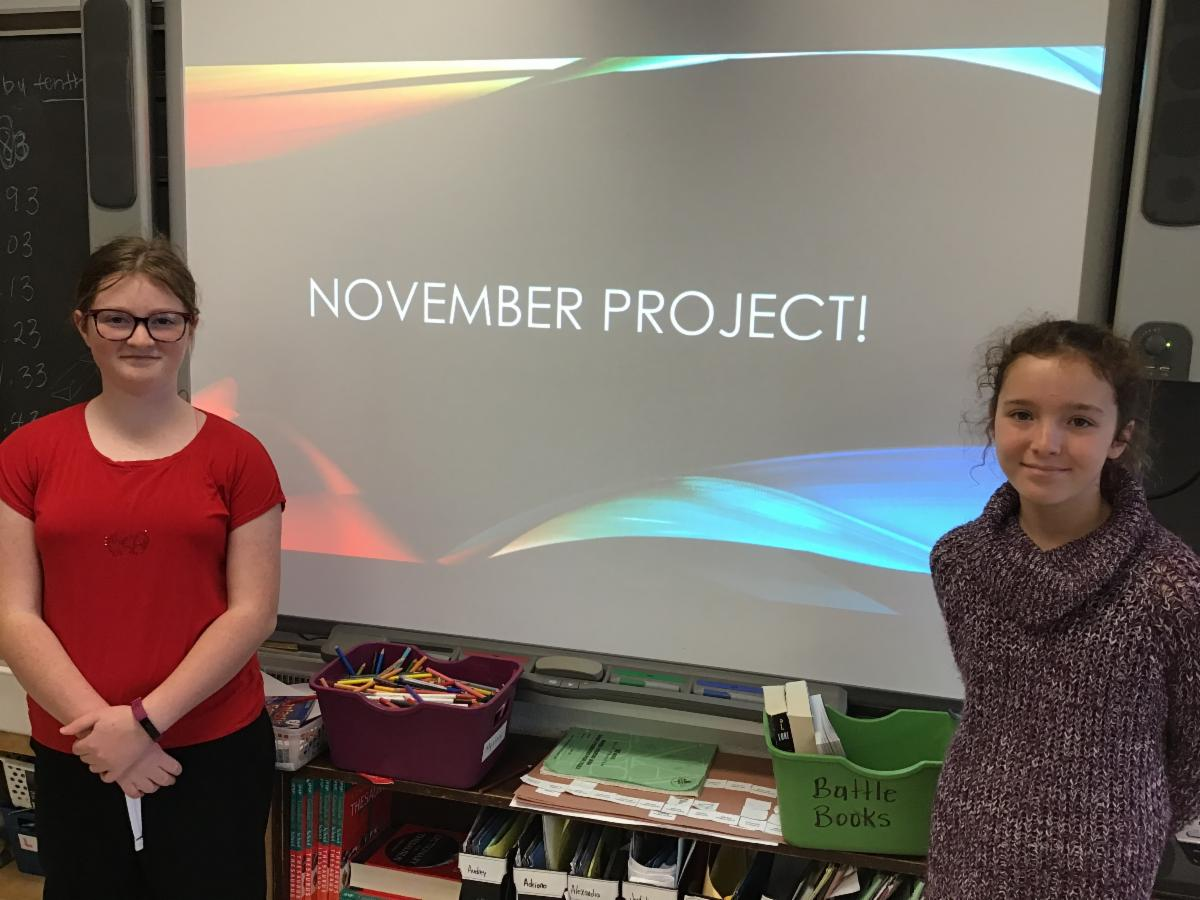 Two female students presenting their November Cyber Security tips