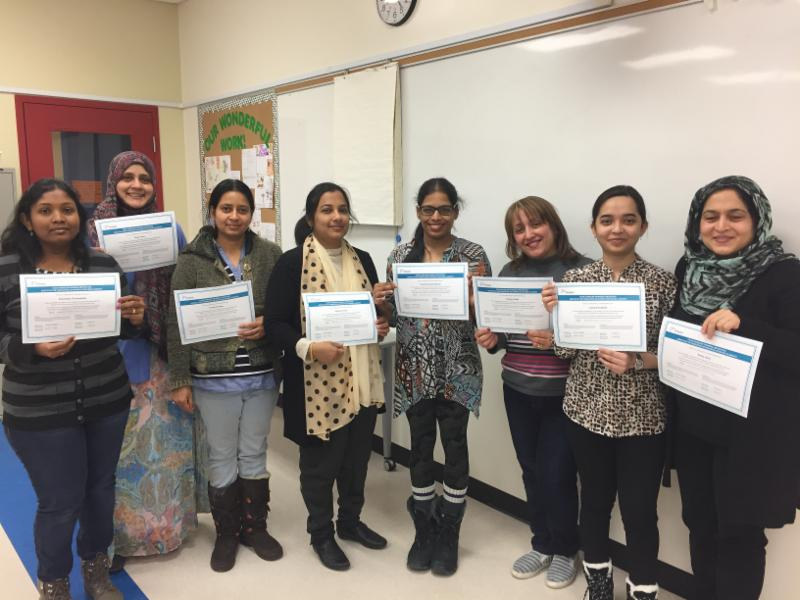 Eight adult women holding certificates