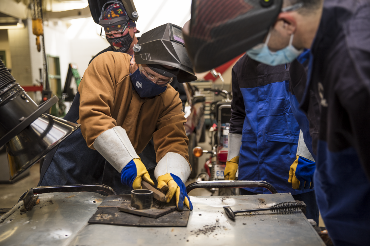 People working on welding project