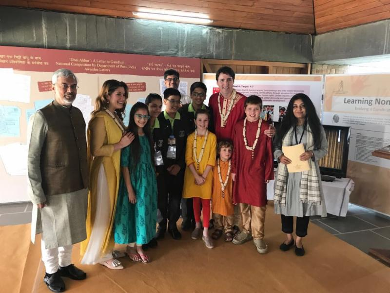 Prime Minister standing with a group of people and students in a school in India