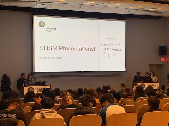 Students presenting their ideas for Lakeridge Health fundraising to hospital staff
