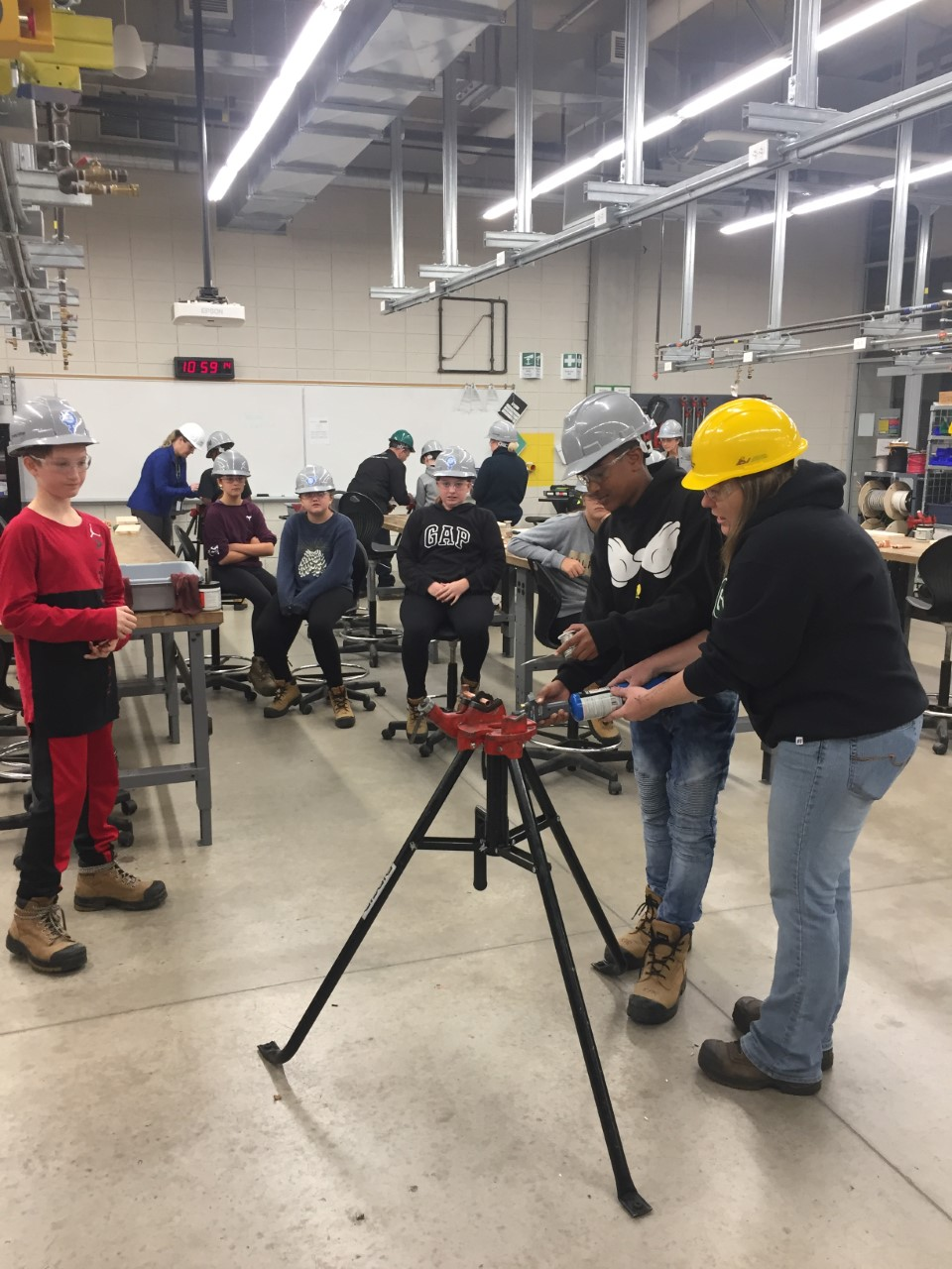 Students measuring in a trades classroom