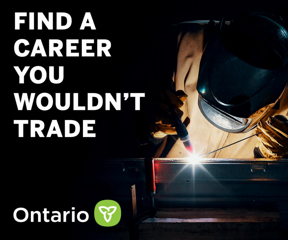 Person welding with Ontario Government logo