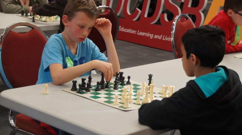 Two male students playing chess