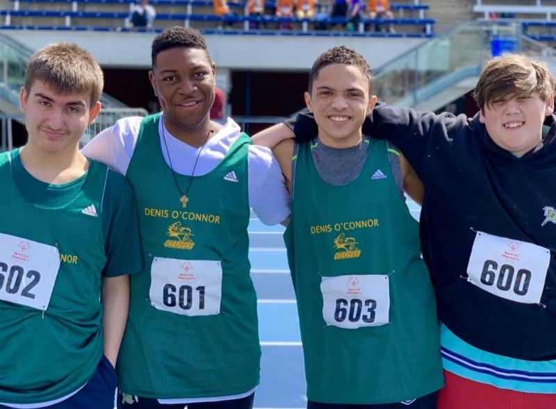 For male students lock arms in arms getting on the track at the special olympics