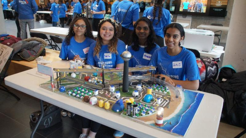 Four female student with their future city model