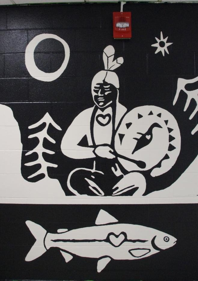 Mural of a fish speaking to an Indigenous person telling him that the fish are dying in the oceans and that help is need to keep our oceans and fish.