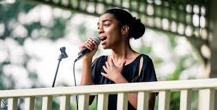 Female student singing outside