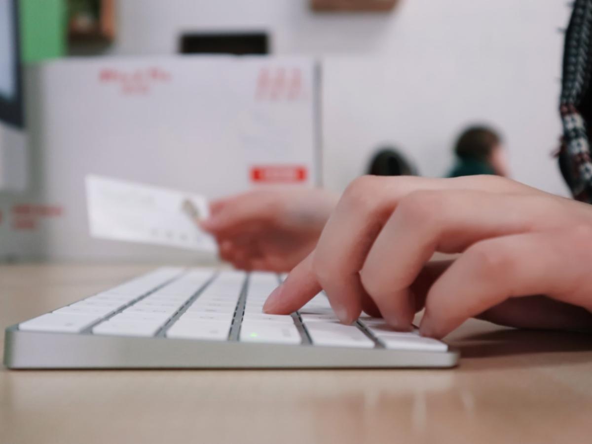 Hand working on a keyboard.