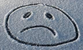 Sad face drawn in the snow