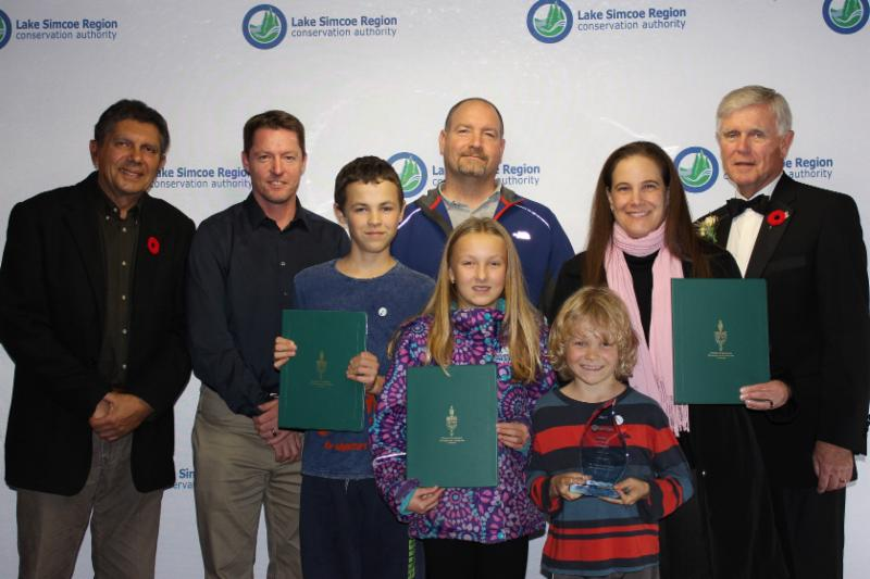 Students, parents and principal from St. Joseph Catholic School in Uxbridge accept an award for their Conservation Work