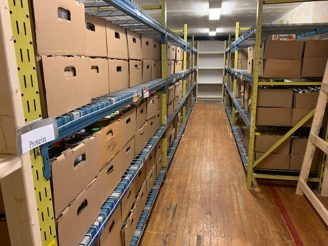 Completed project with all the food boxes nicely placed on the shelving units in the storage room.
