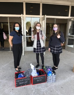 Ms. Arsenau and students at the menstrual product drive