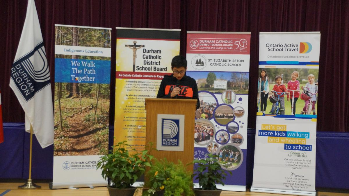 Male student speaking at the podium