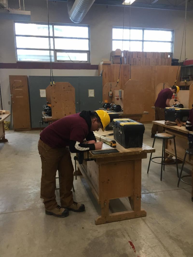 Male student working in a woodworking classroom