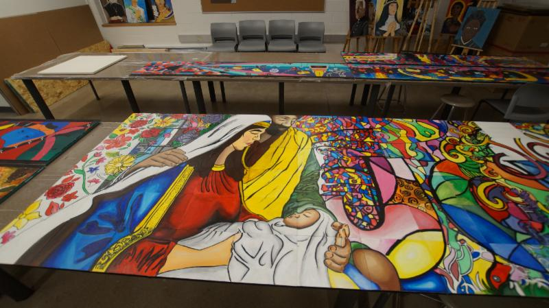 Students' paintings on display in a classroom