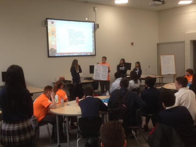 Students present their ideas to Habitat for Humanity employees and volunteers