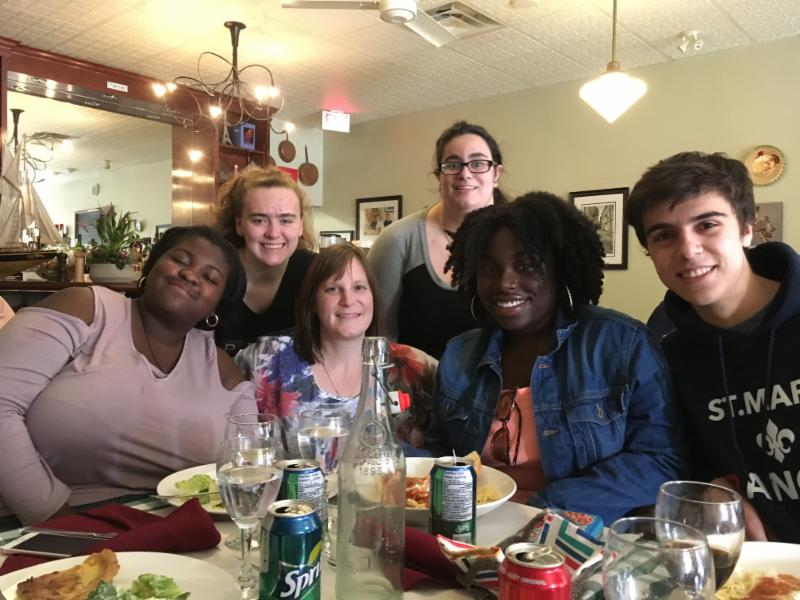 Students and staff enjoying a meal at a French restaurant