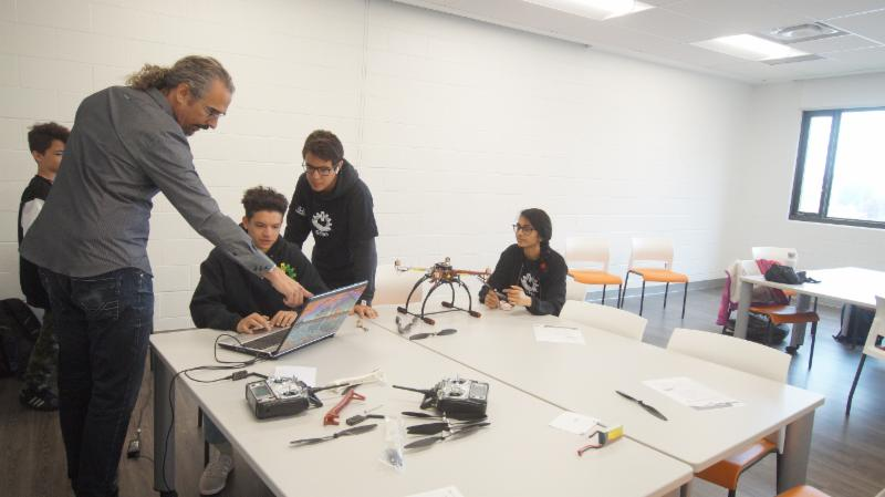 Secondary students learning how to build a drone
