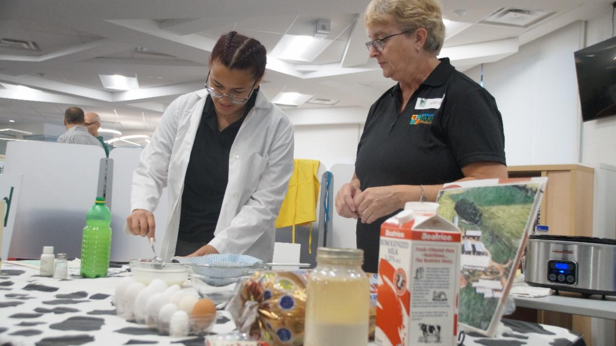 Female student mixing as part of a demonstration at Farm Connection