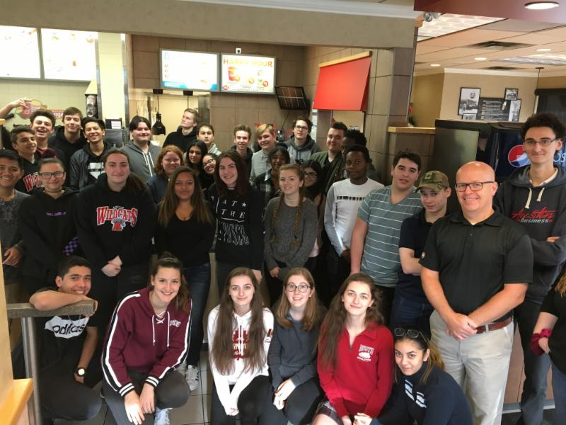 Group picture of students with owners at Dairy Queen