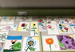 Students' dot artwork on display