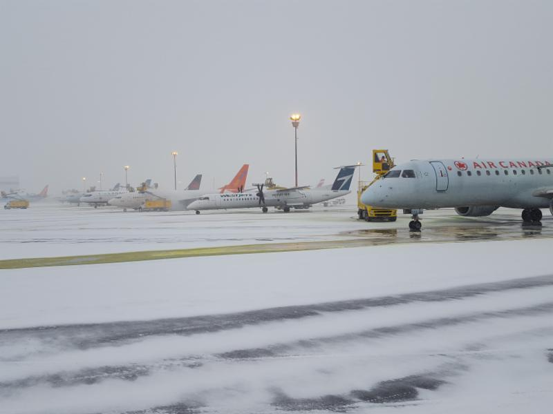 Airplanes being de-iced at an airport