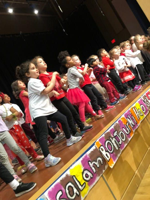 Kindergarten students dancing on stage