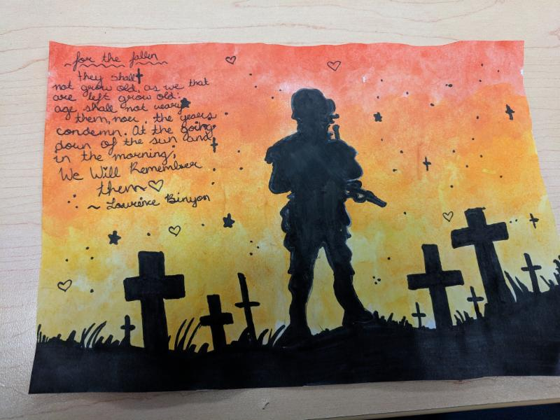 Student's award winning artwork of a soldier in a field filled with crosses at sunset.