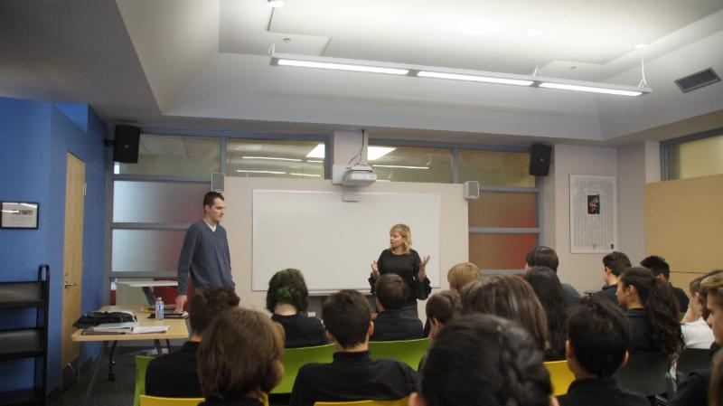 Female teacher introducing male adult guest speaker