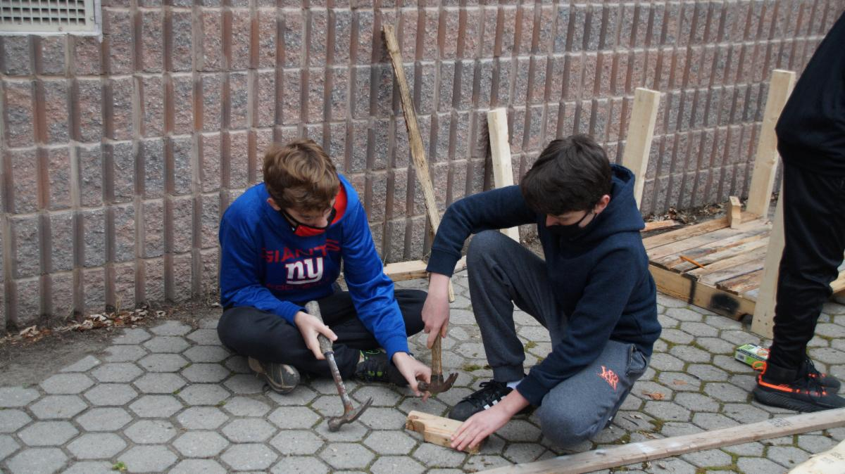Two male students with hammers