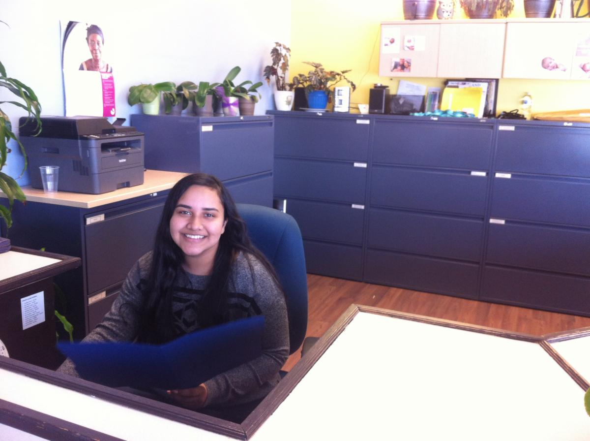 Female student sitting at a desk at her coop placement