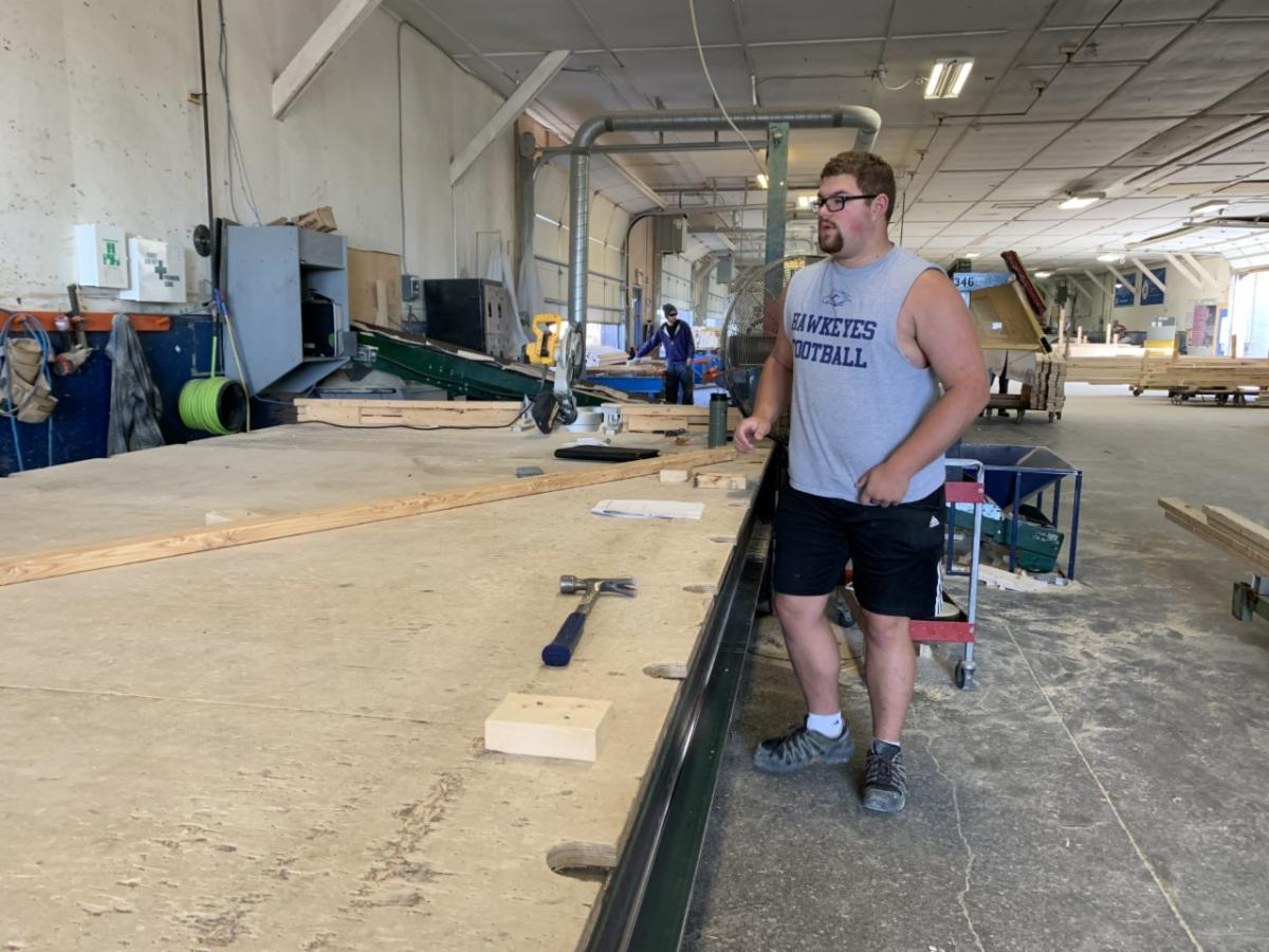 Male student working in a wood working shop