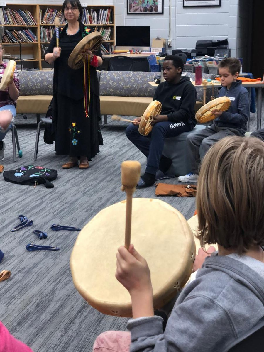 Students learning how to use the hand drums.