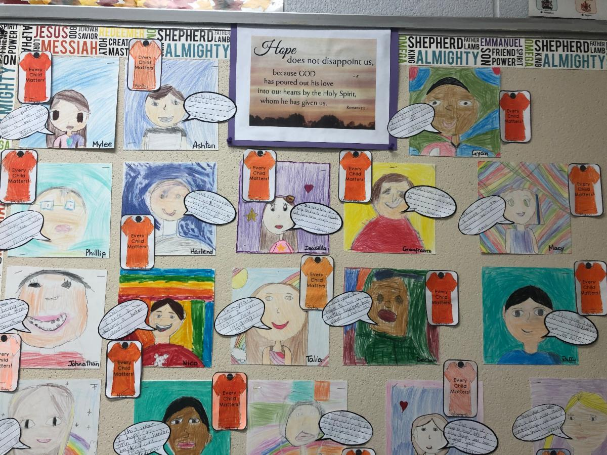 Students learning on Orange Shirt Day and Residential school displayed on a bulletin board