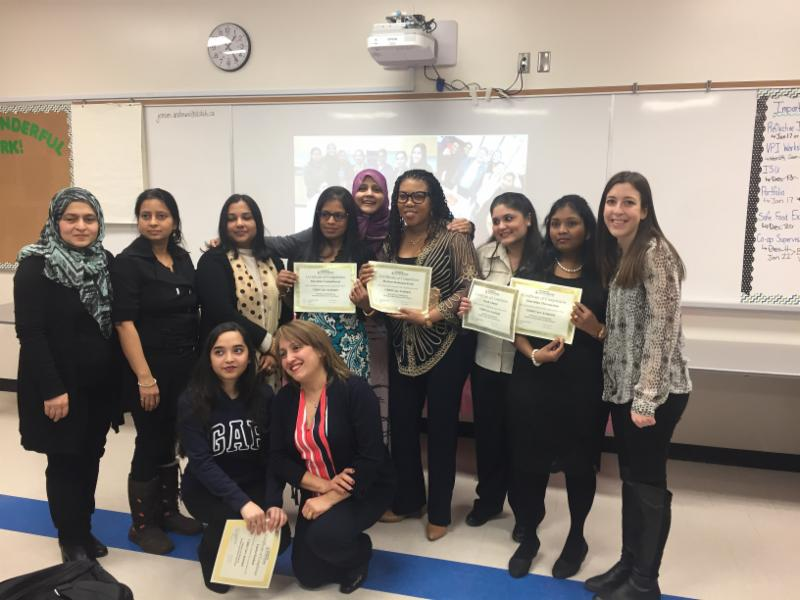 Child Care Assistants from Ajax Campus holding certificates