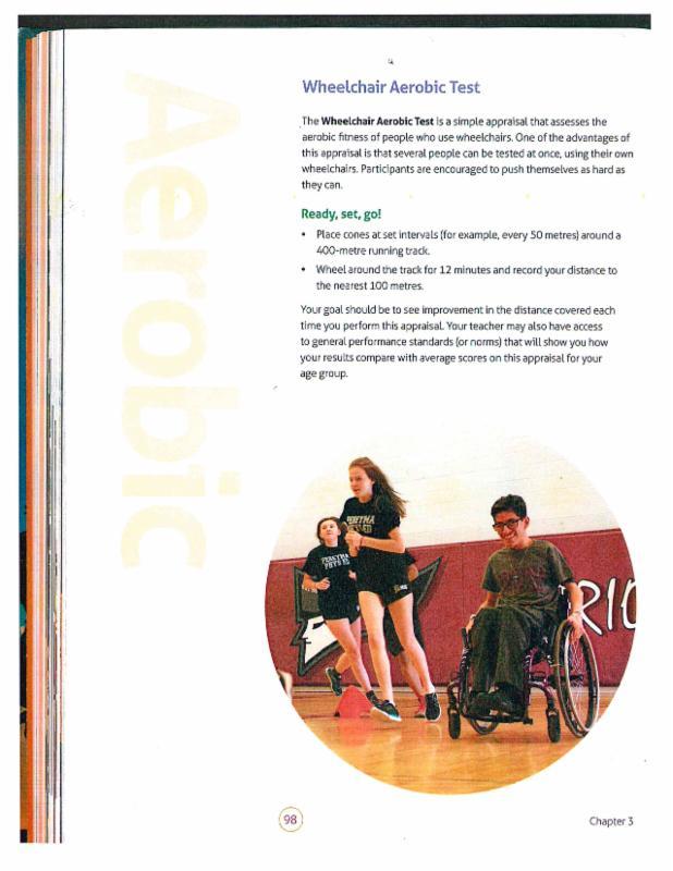 Student wearing Pereyma gym uniform pushing his wheel chair around the gym