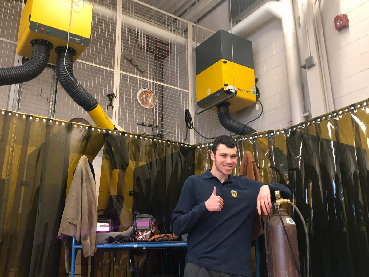 Student with welding equipment