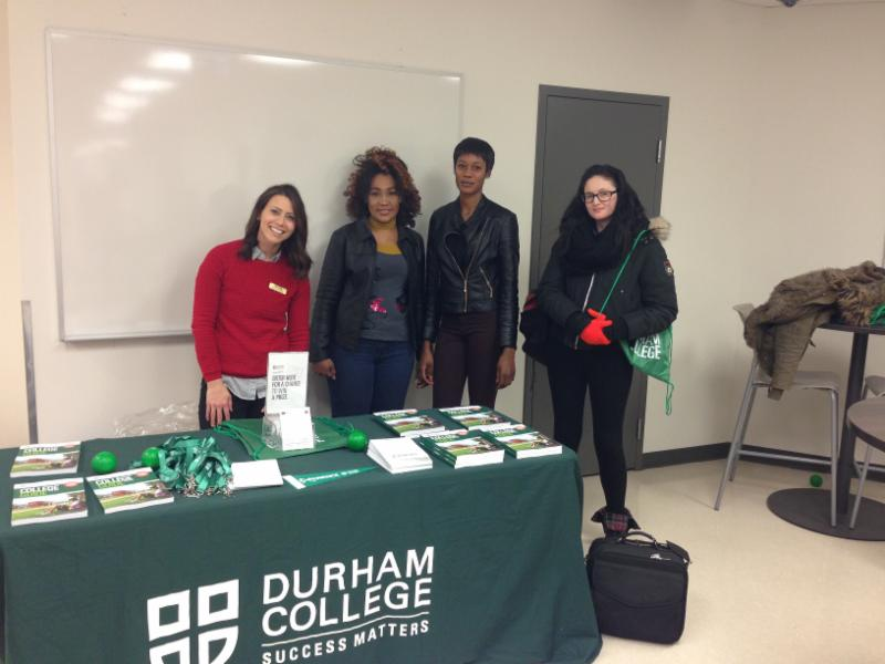 Students in Continuing Education talk with a representative from Durham College.