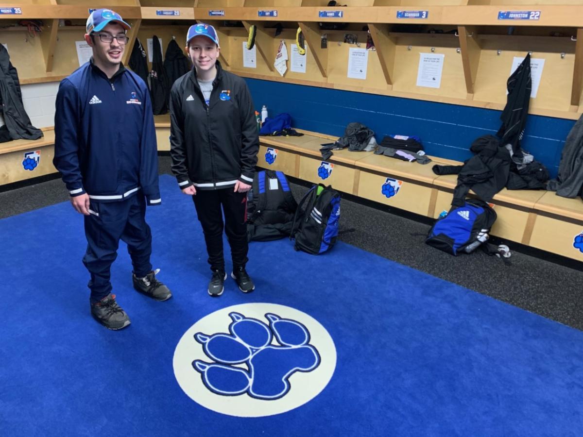 Female student with Ontario Tech Ridgeback Women's Hockey Team Equipment Manager.