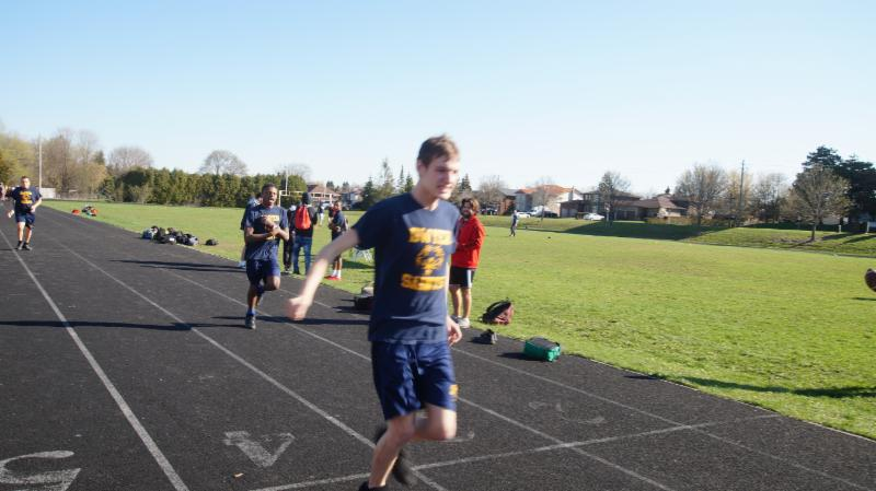 Male student crosses the finish line first