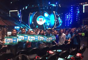 Students holding We Gen signs at WE Day Toronto