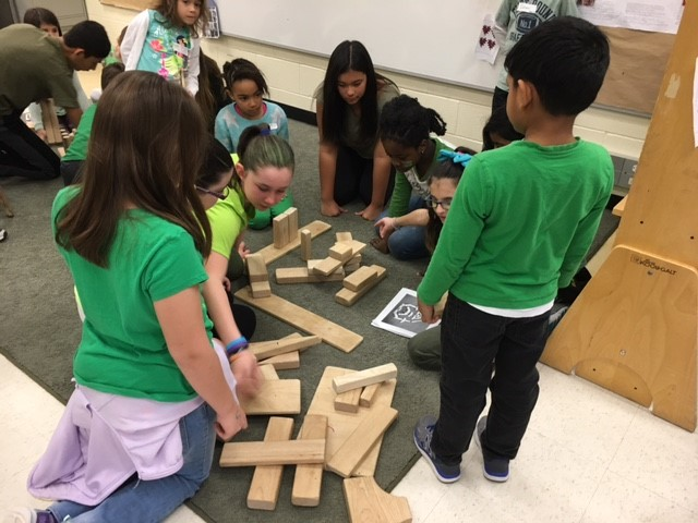 Students building with wooden blocks